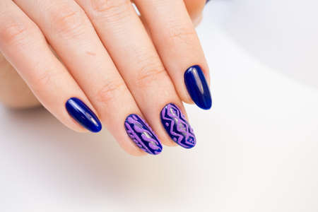 Natural nails, gel polish. Perfect clean manicure with zero cuticle. Nail art design for the fashion style. Stock Photo