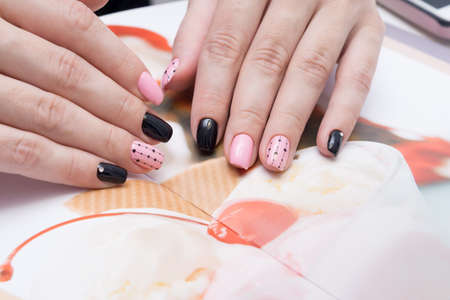 Amazing manicure and natural nails with gel polish. Attractive modern nail art design. Standard-Bild