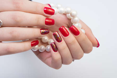 Amazing manicure and natural nails with gel polish. Attractive modern nail art design. Stock Photo