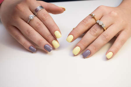 Attractive womens hands. Natural nails with beautiful manicure. Stock Photo