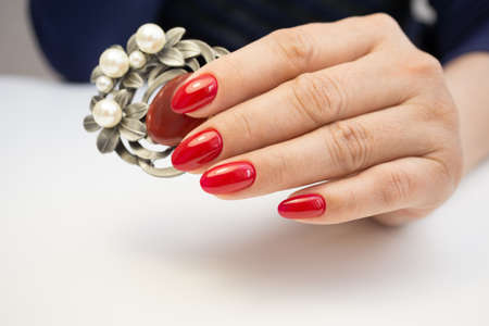 womens hands: Attractive womens hands. Natural nails with beautiful manicure. Stock Photo