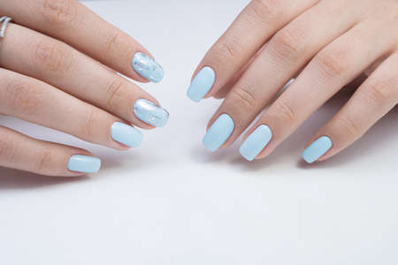 Womens hands and amazing natural nails. Ideal manicure with gel polish and nail art. Stock Photo