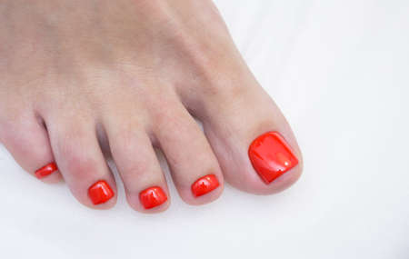 Womens feet and amazing natural nails. Ideal pedicure with gel polish and nail art.