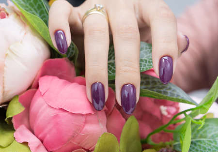 salon and spa: Womens hands and amazing natural nails. Ideal manicure with gel polish and nail art. Stock Photo