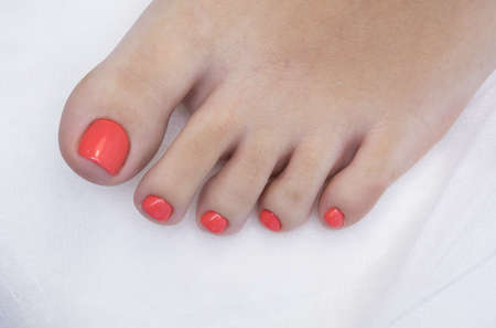 applied: Womans foot with gel polish applied. Natural nails.