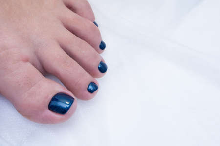 Women's foot and clean pedicure, natural nails. Gel polish applied.