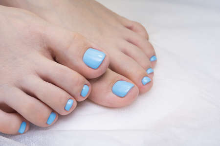 Womens foot and clean pedicure, natural nails. Gel polish applied.