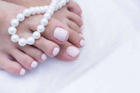 Womens feet with amazing pedicure. Nails with gel polish applied. Stock fotó
