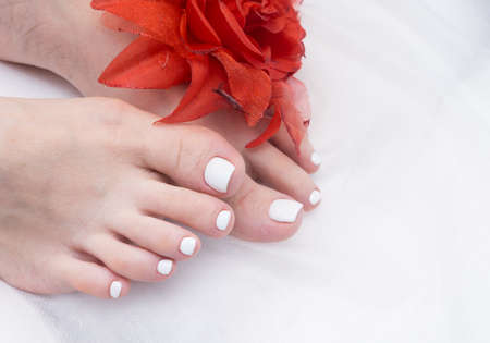 Women's feet with amazing pedicure. Nails with gel polish applied.