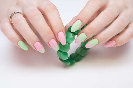 Natural nails with gel polish applied. Ideal manicure and women's hands.