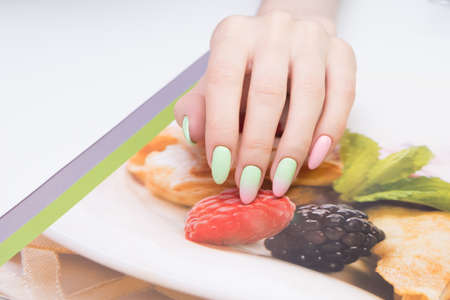 Natural nails with gel polish applied. Ideal manicure and women's hands. Stock Photo - 92332451