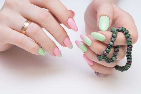 Natural nails with gel polish applied. Ideal manicure and womens hands. Stock Photo