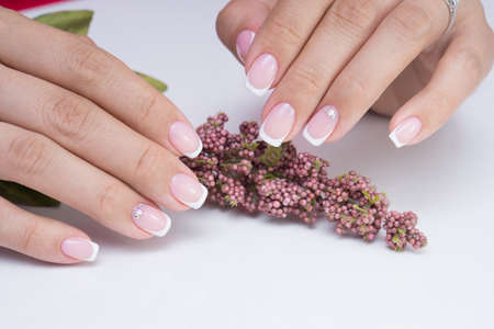 Natural nails with gel polish applied. Ideal manicure and womens hands. Stock fotó