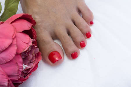 Pedicure and gel polish on womens feet. Stock Photo
