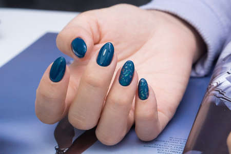 Beautiful natural nails and attractive manicure on women hands.