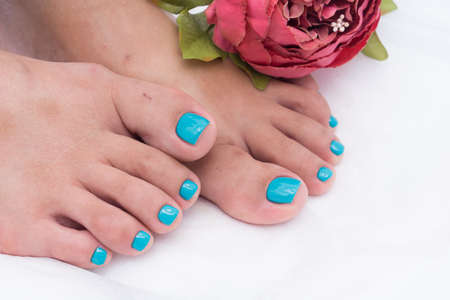 Awesome pedicure, women's feet. Colorful and stylish design.
