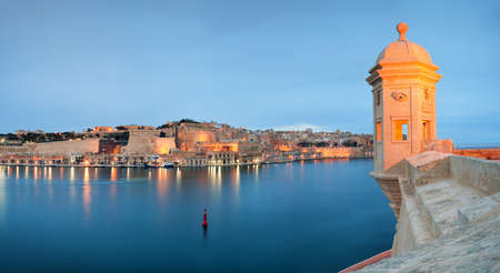 View at Valletta fortifications from Senglea. Tower with eye and ear, situated on the Spur, the seaward bastion of Senglea, a part of the fort Saint Michael. High resolution panorama. Stock fotó