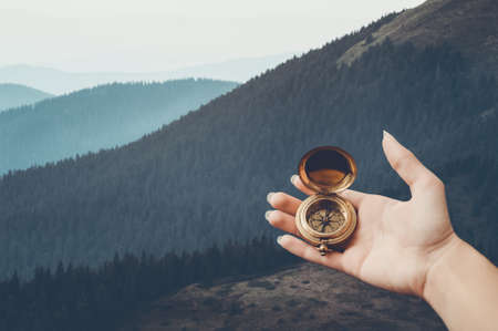 A hand holding vintage compass