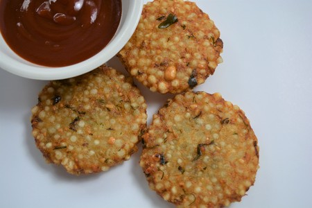 Indian traditional fried food Sabudana vada  Sago cutlets with tomato ketchup.