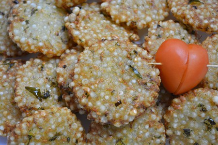 Indian traditional fried food Sabudana vada  Sago cutlets with tomato heart.