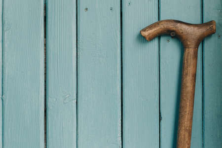 Blue background on which is a wooden cane Banco de Imagens