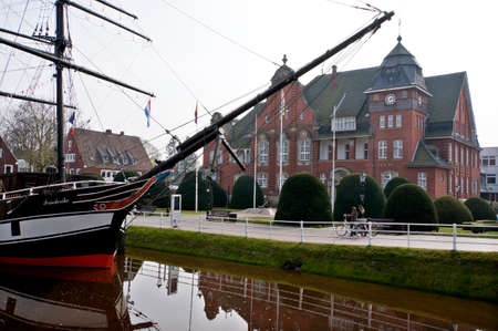 Brigg Friederike von Papenburg in open-air maritime museum - in the background the town hall, Papenburg, Lower Saxony, Germany,