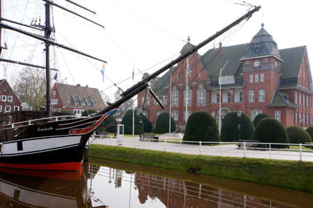 brigg: Brigg Friederike von Papenburg in open-air maritime museum - in the background the town hall, Papenburg, Lower Saxony, Germany,