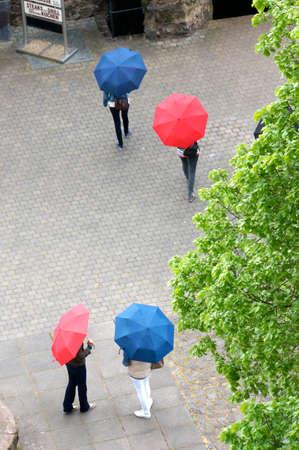 saar: Tourists with umbrellas in the courtyard, Rhineland-Palatinate, Germany, Saar castle Stock Photo