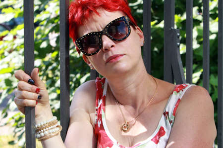 sympathetic: red-haired woman of about 50, Cologne, North Rhine-Westphalia, Germany Stock Photo