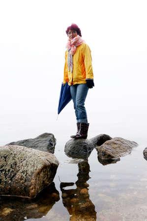mecklenburg western pomerania: Woman ballanciert over stones on the seashore, Thiessow, Mecklenburg, WESTERN Pomerania, Germany, Klein Zicker, Rgen Editorial