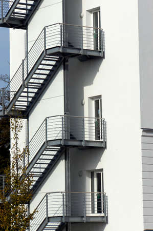 rehabilitated: renovated old building with fire escape, Putbus, Rgen, Mecklenburg-Vorpommern, Germany Stock Photo
