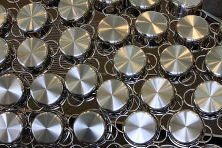 multiplicity: various pots  of  stainless steel, Berlin, Germany