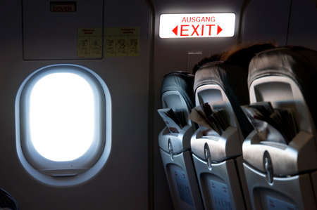 Emergency exit in an airplane Reklamní fotografie - 34991535