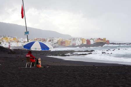 Lifeguards on the deserted beach, Playa Jardin, Puerto de la Cruz, Tenerife, Canary Islands