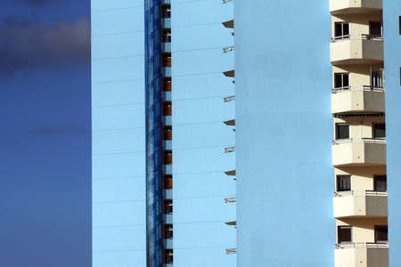 echoes: blue high rise building with balconies and fire escape, Los Real echoes, Tenerife, Canary Islands