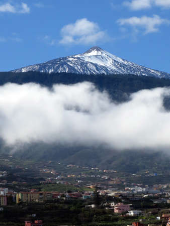 accumulate: Trade wind clouds accumulate at the Teides Puerto de la Cruz, Tenerife, Canary Islands, Spain Stock Photo