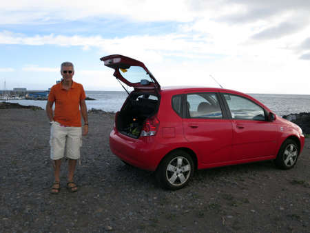 People with his rental car, Tenerife, Canary Islands, Spain Editorial