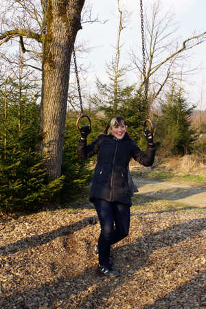 stoned: young woman stoned to rings on the fitness course, Neuenrade, North Rhine-Westphalia, Germany