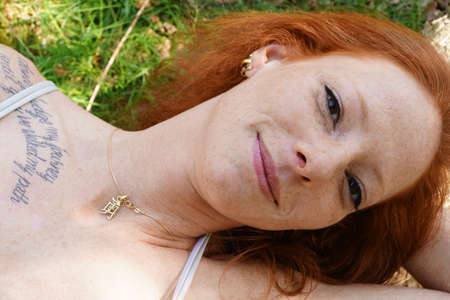 freckle: Portrait of a young red-haired woman