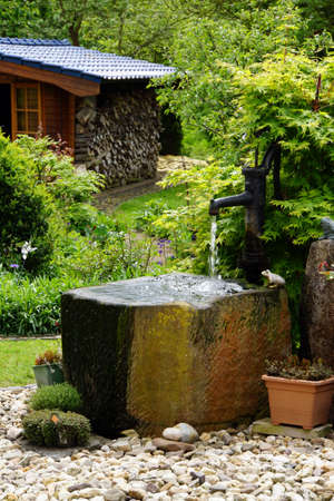trough: Water trough with hand pump in the garden