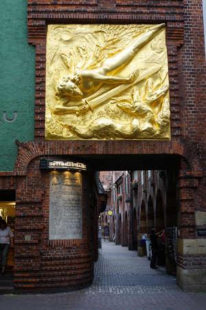 The Light Bringer, facade relief of Bernhard Hoetger, above the entrance to Bttcherstrasse, Bremen, Germany Editorial