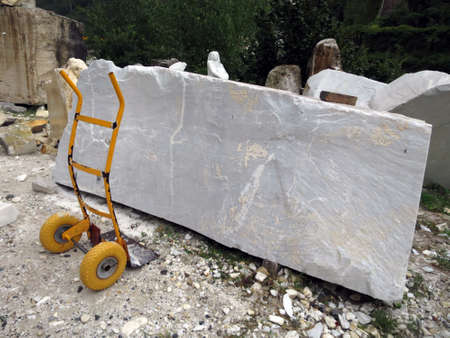 craft on marble: Block of marble in the stone sculpture workshop, Carrara, Tuscany, Italy Stock Photo