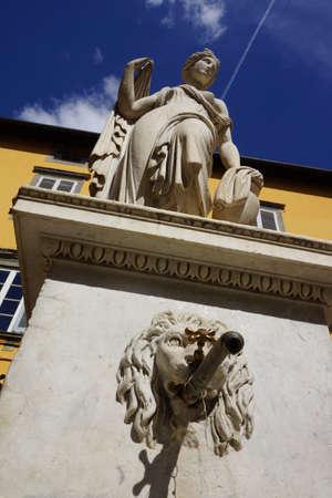 piazza: fountain Fontana Pupporona in Piazza del Salvatore. Lucca, Tuscany, Italy Editorial