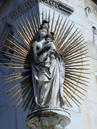 aureole: Mary statue at a house wall, Lucca, Tuscany, Italy