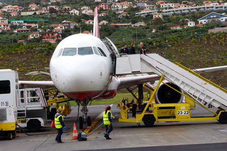 landed: landed aircraft is serviced, Funchal, Madeira, Portugal