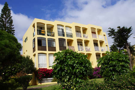 multifamily: Multifamily house with green garden, Canico, Madeira, Portugal Editorial