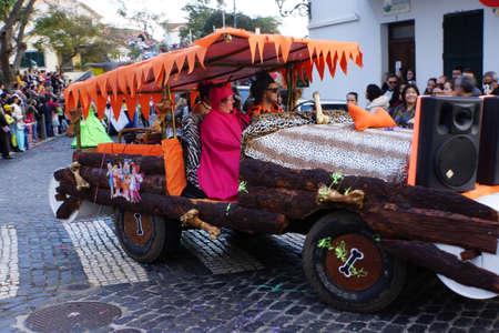 feather boa: big carnival parade, Santa Cruz, Madeira, Portugal Editorial