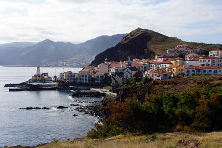 tourismus: Holiday village with church, harbor and lighthouse, Canical, Madeira, Portugal Stock Photo