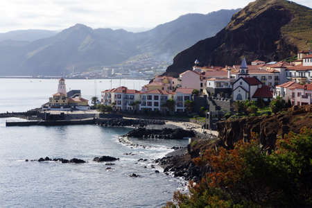 ferien: Holiday village with church, harbor and lighthouse, Canical, Madeira, Portugal Stock Photo