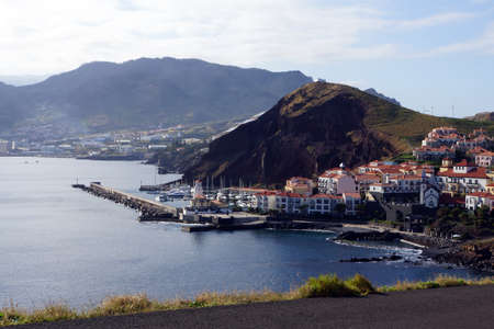 landschaft: Holiday village with church, harbor and lighthouse, Canical, Madeira, Portugal Stock Photo